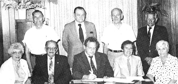 Board of Directors, 1986. Seated (L to R): Emma Petraitis, Motiejus Batutis, Julius Kuxas, William Sebastian, Aldona Daukus. Standing: Bruno Matelis, Grozvydas Lazauskas, Peter Dapser, Vyto Uznys. Missing: Algirdas Mickevicius.